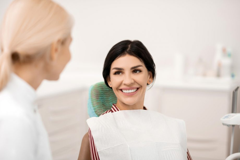 female dentist consulting with female patient